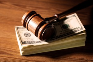 gavel and stack of money on the desk of a Clinton Township child support lawyer