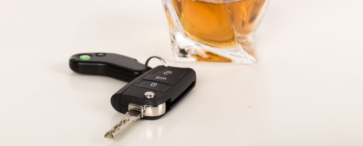 car keys and drink on a table from the view point of a Clinton Township DUI attorney