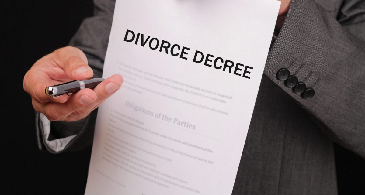 divorce decree in the hands of a Macomb County divorce attorney