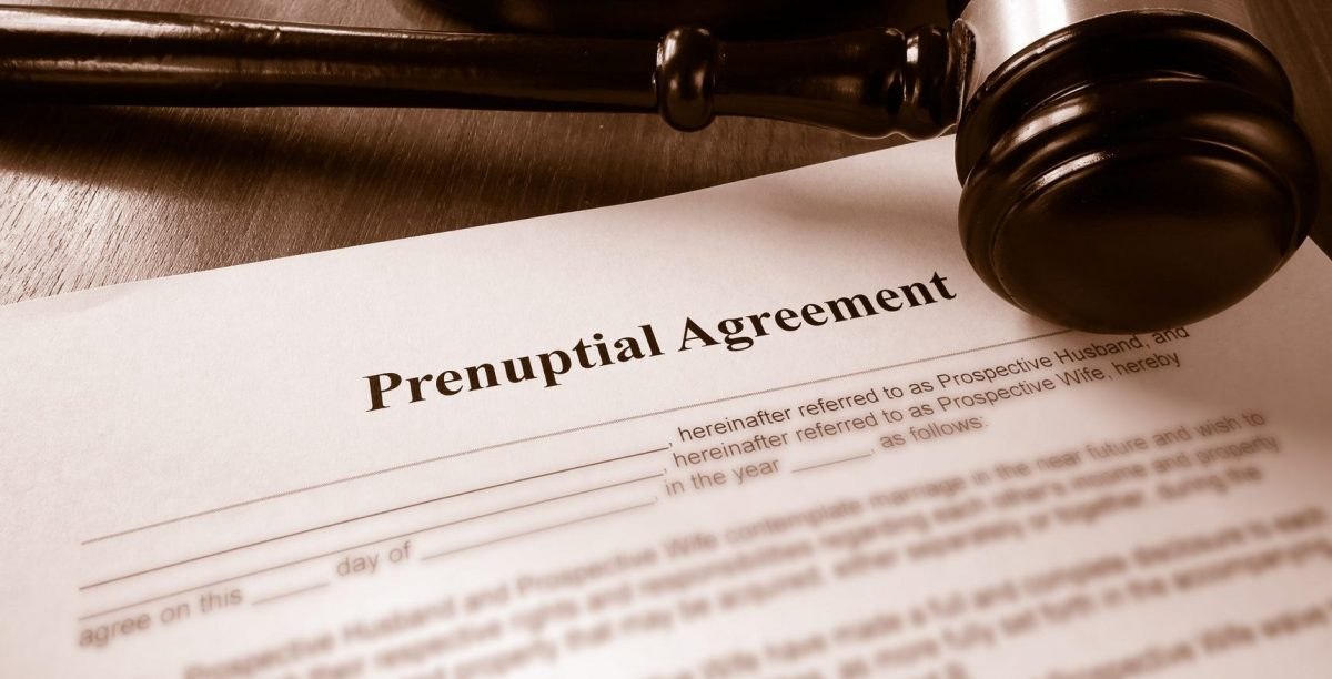 prenuptial agreement and gavel on the desk of a Clinton Township divorce attorney