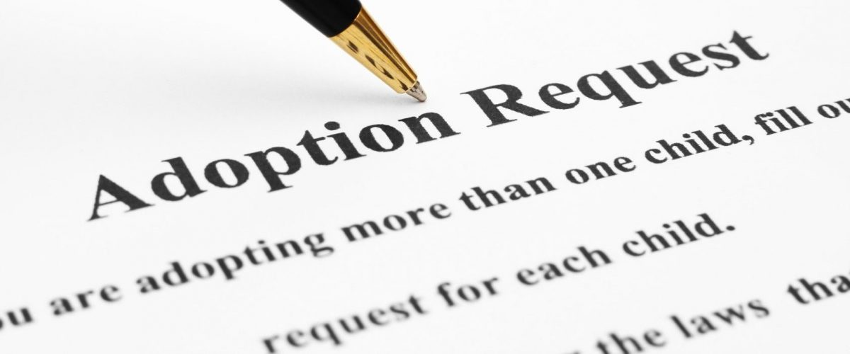 adoption request being filled out by a Clinton Township adoption attorney