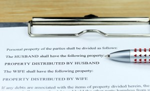 property division agreement on the clipboard of a Clinton Township family lawyer