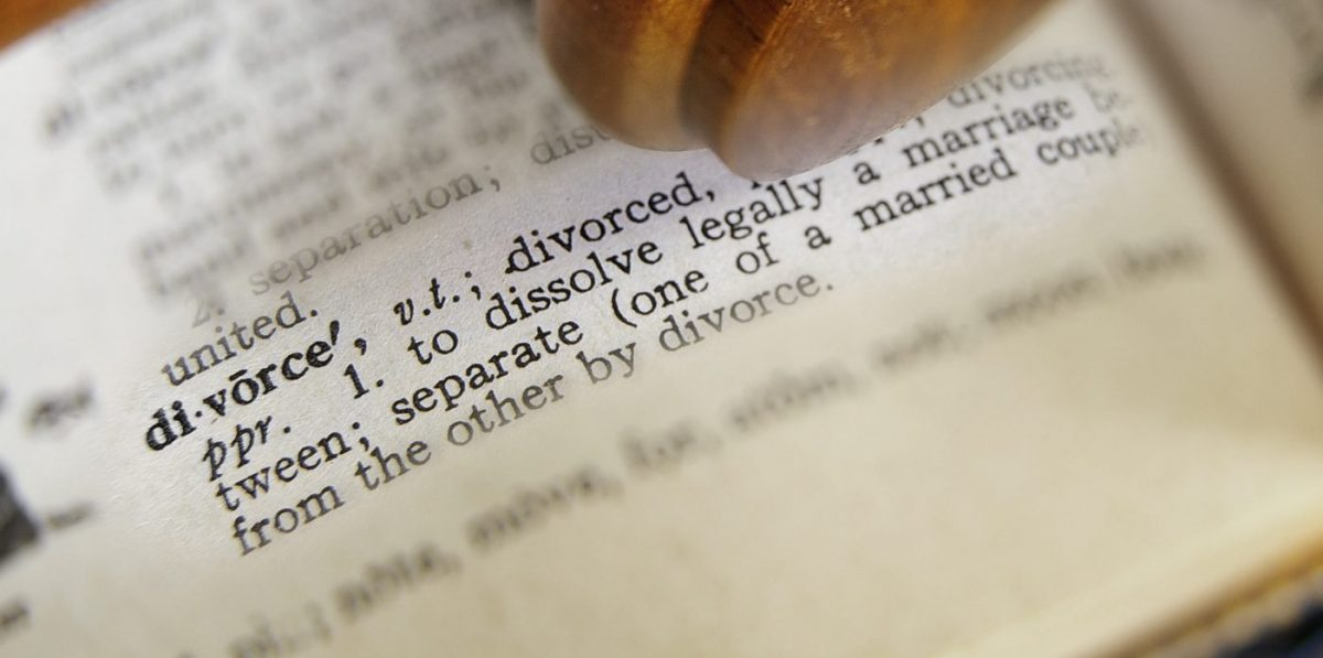definition of divorce on the desk of a Clinton Township divorce attorney
