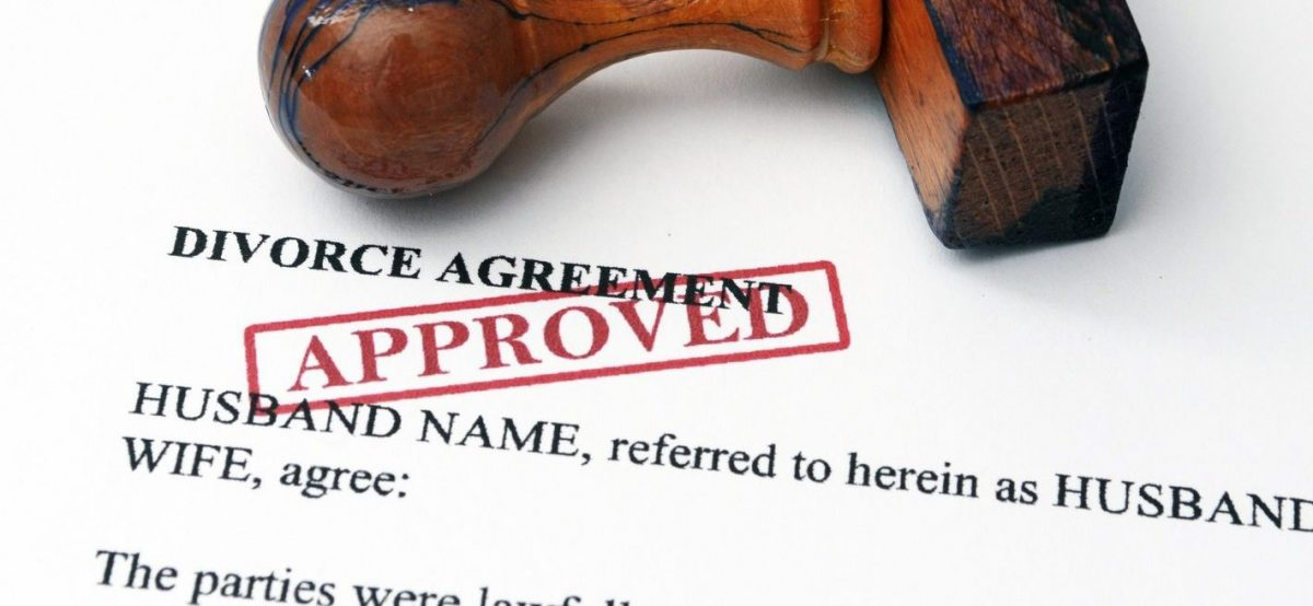 divorce agreement and approval stamp on the desk of a Clinton Township divorce attorney