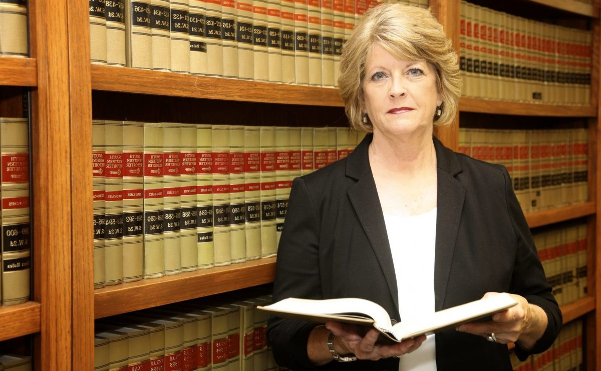 Clinton Township family law attorney in front of legal books
