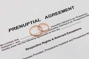 prenuptial agreement and wedding bands on the desk of a Clinton Township family attorney