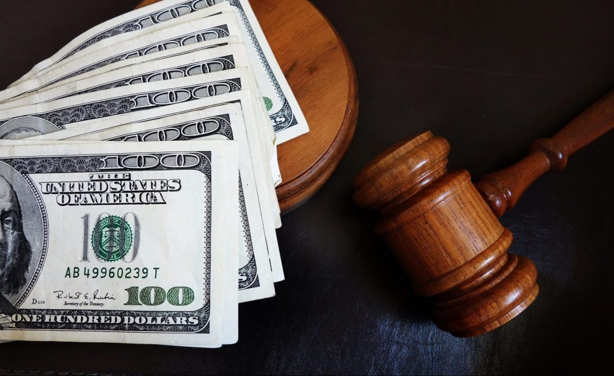 gavel and money on the desk of a Clinton Township child support lawyer who just won a settlement