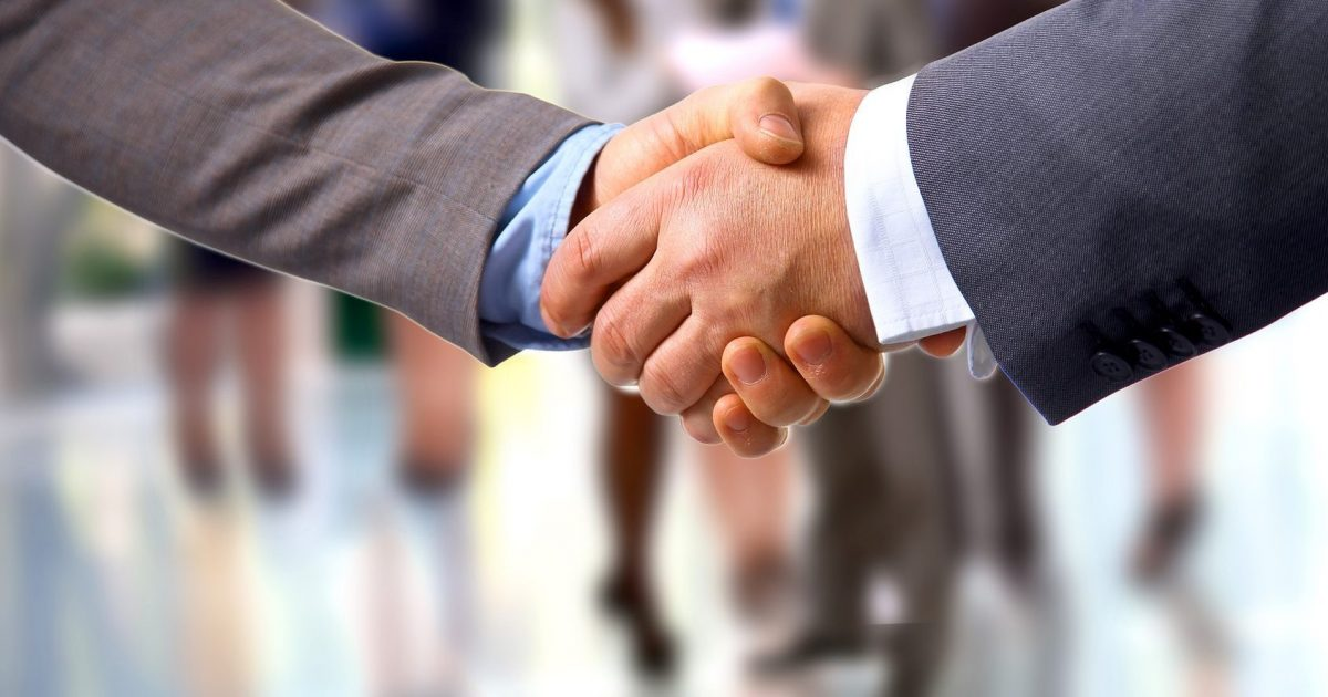 shaking hands with a Clinton Township divorce lawyer