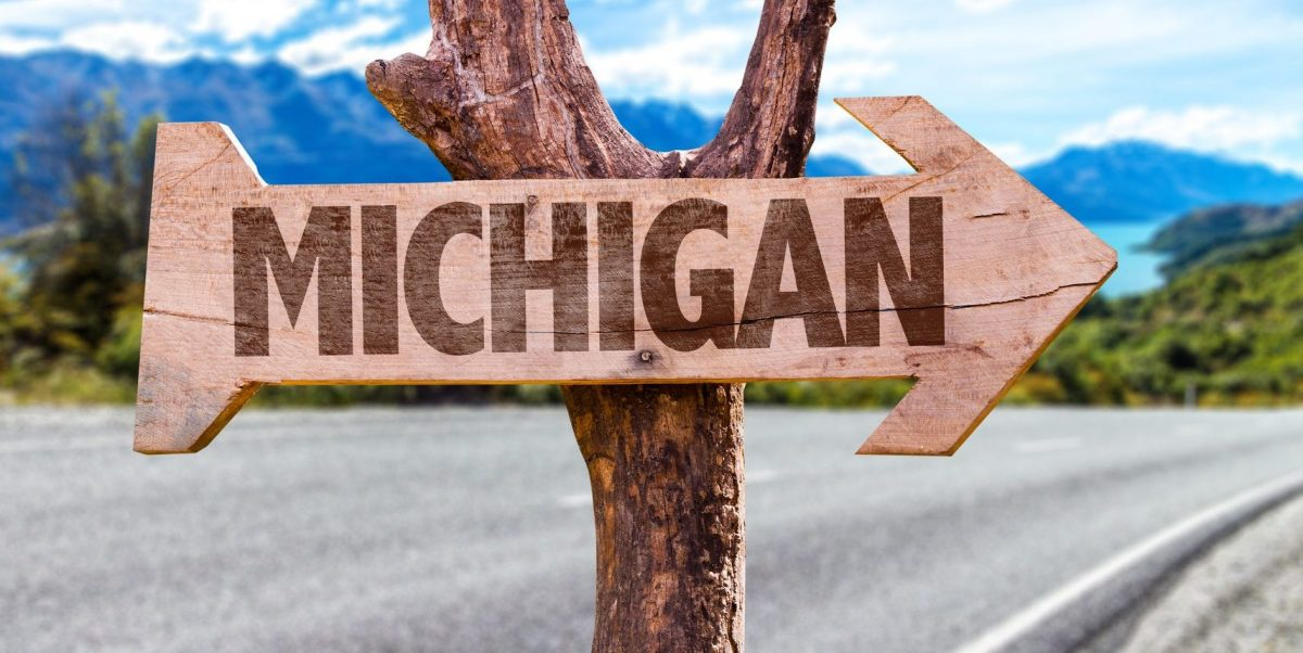 Sign pointing to Michigan as viewed by a Clinton Township divorce attorney handling an out of state divorce