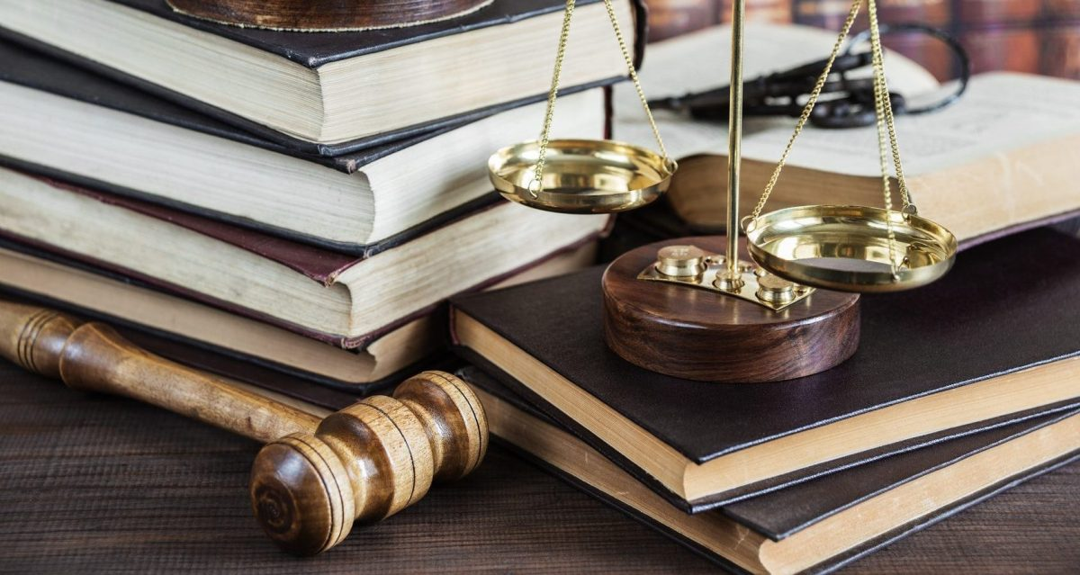books and gavel on the desk of a Clinton Township divorce attorney