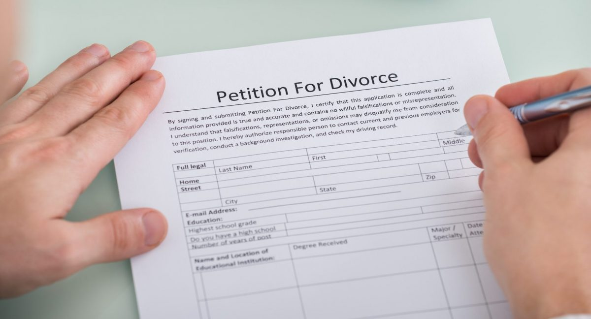 divorce petition being filled out by a Clinton Township divorce lawyer for his client