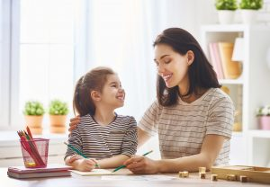 Mother and daughter are learning to write after a successful case with a divorce lawyer near me