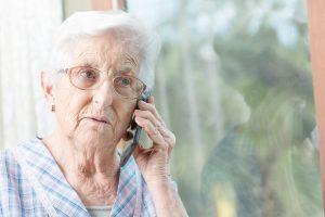 Senior woman speaking on mobile phone to a clinton township divorce lawyer