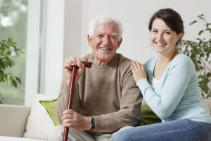 Smiling old man holding a cane and smiling young woman who just called a divorce attorney washington township