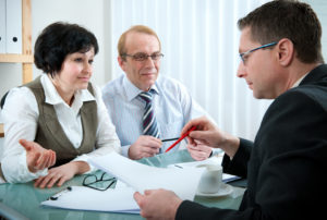 senior married couple meeting with property division divorce lawyer in Rochester