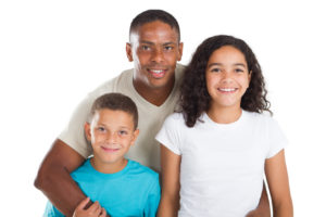 father with his children going through divorce and seeking a Washington Township Child Custody lawyer