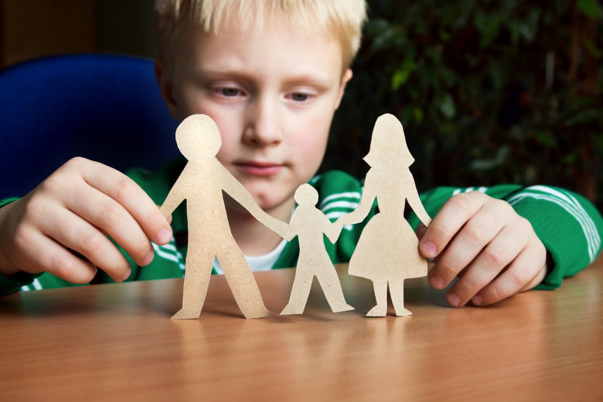 Child with a paper family representing how our Michigan child custody lawyers can help you with your case