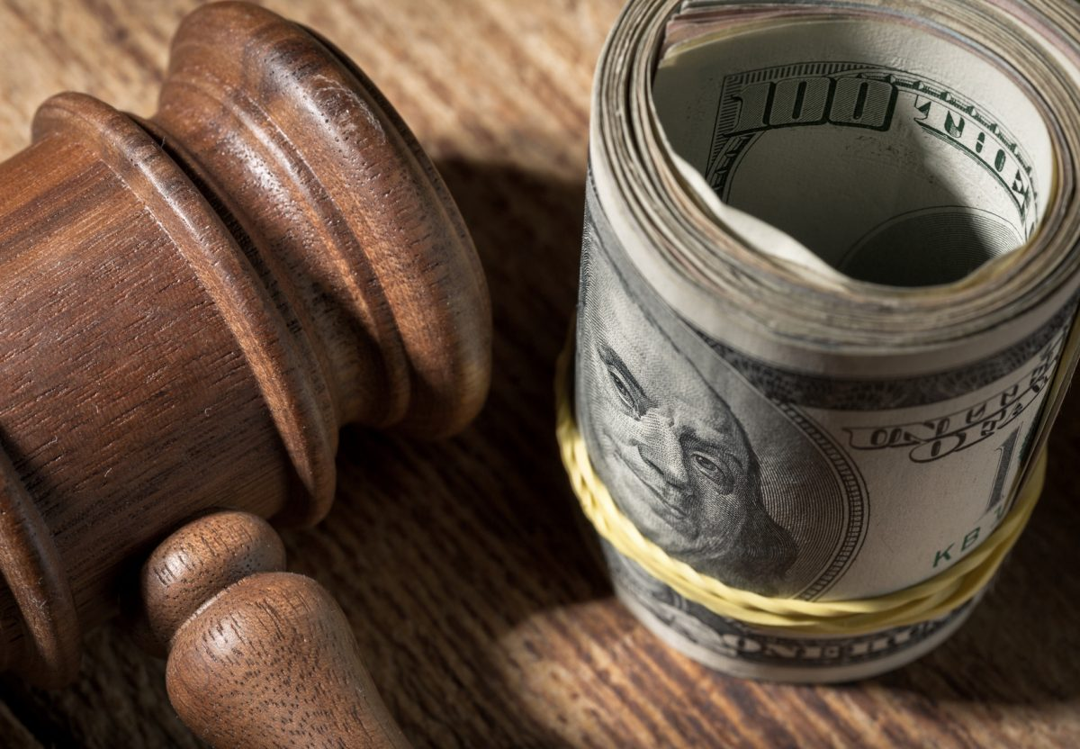 Money roll and gavel representing how our family law attorneys can assist you with alimony and spousal support