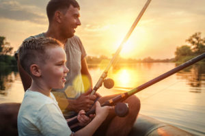 A father and his son fishing during their visitation time, for help with child custody see a family law attorney St. Clair Shores.