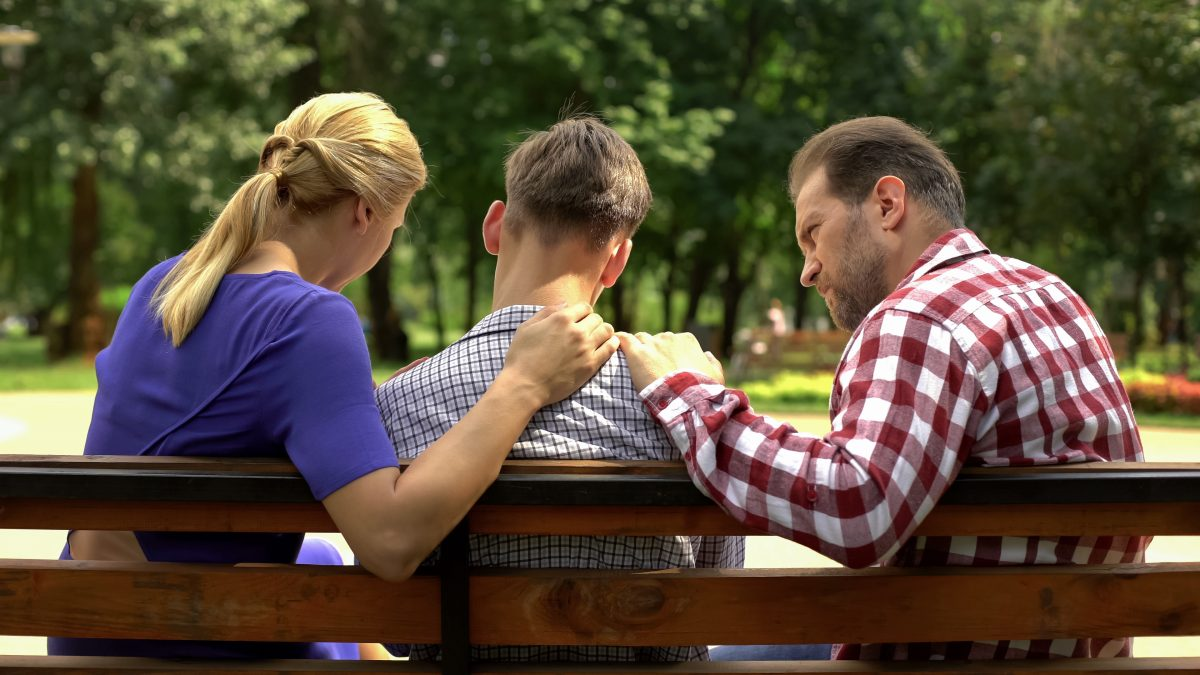 A mom and dad speaking to their teen son about their decision to divorce, for custody arrangements contact our Roseville family law attorney.