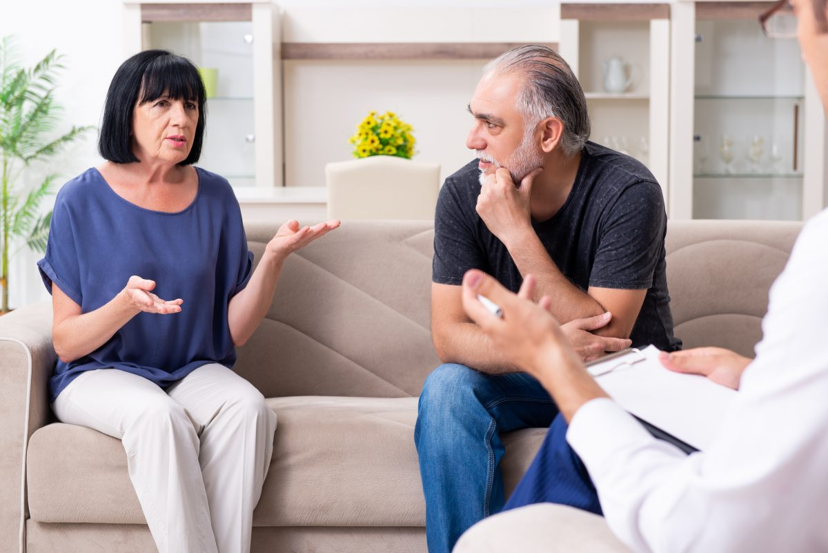 Older couple meets with a Michigan family lawyer.