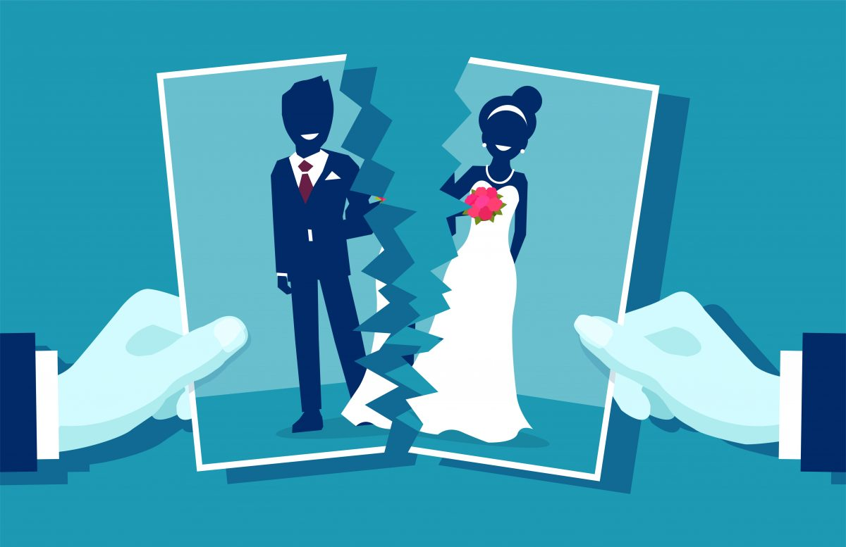 A wedding photo that is being ripped apart, for a smooth and friendly divorce filing meet with our Birmingham Divorce Attorneys.