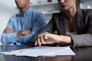Couple talking with papers on table,Divorce Lawyer in Birmingham, MI