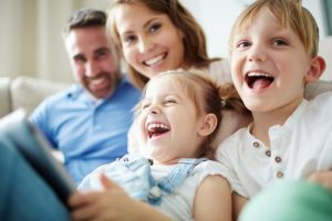 Family laughing and happy, look for a knowledgeable Family Law Lawyers Birmingham, MI to handle your child custody case.