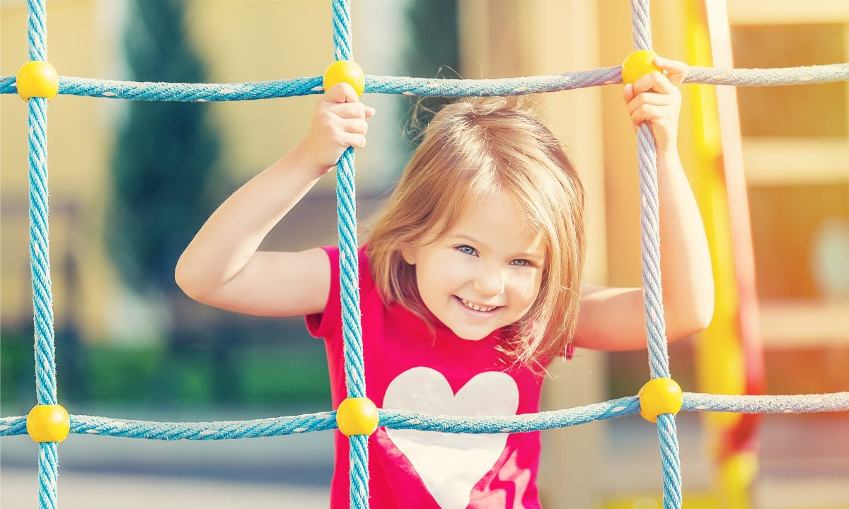 Little girl playing on playground, when needing help with a nonpayer of child support turn to Clinton Township child support attorney.